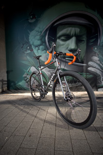 Gunmetal Gloss Escapade 105 Hydraulic, optional orange bar tape